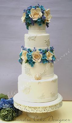 I love the floral detail and how it is not over barring throughout the cake! http://mywalkdowntheaisle.com