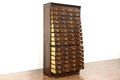 """A sixty drawer file cabinet from about 1895 is signed by famous maker, """"Yawman & Erbe, Rochester, NY"""" and also """"Shannon File Cabinet"""" in worn. Cabinet Drawers, Chest Of Drawers, Filing Cabinet, Library Cabinet, Tool Storage Cabinets, Printers Drawer, Pull Out Shelves, Vintage Library, Antique Cabinets"""