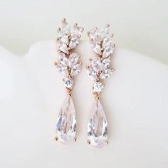 These crystal bridal earrings feature water drop grade AAA cubic zirconia drops with dainty leaves.These sparkly earrings x times plated for a color resistant They are lightweight about Bride Earrings, Art Deco Earrings, Silver Drop Earrings, Bridesmaid Earrings, Crystal Earrings, Vintage Bridal Earrings, Rose Gold Wedding Earrings, Rose Gold Wedding Jewelry, Prom Earrings