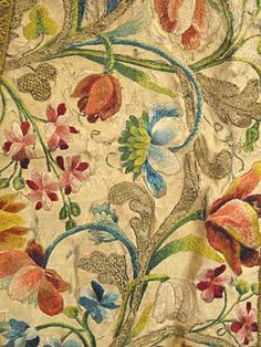 detail of an 18th century floral embroidered open robe on the blog Trouvais ~ French interiors, rough luxe, flea market finds.  Found on Augusta Auctions site