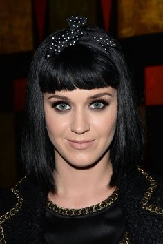 Katy opted for a polka-dotted headband and smoked-out, black liner at the Moschino dinner during Milan Fashion Week.