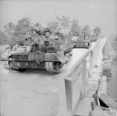 Carriers of (Motor) Grenadier Guards, Guards Armoured Brigade, Guards Armoured Division, cross 'Euston Bridge' as they deploy for Operation 'Goodwood', 18 July 1944 Military Photos, Military History, Normandy Ww2, Cromwell Tank, Home Guard, British Armed Forces, Royal Marines, Ww2 Tanks, British Army