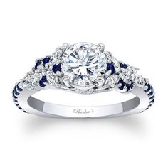 This exquisite sapphire and diamond engagement ring features a white gold cathedral shank, with a prong set round moissanite center. Marquise cut diamonds adorn each side, while small round blue sapphires artfully cascade down the shoulders. Diamond Rings, Diamond Engagement Rings, Diamond Cuts, Black Diamond, Halo Engagement, Solitaire Ring, The Bling Ring, Bling Bling, Art Deco Ring