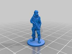 A miniature soldier on a round base with gas mask and AK74u. I used Autodesk 123D catch to combine a series of pictures taken around the person wearing the costume to get a rough 3D model, which I then cleaned up with Sculptris.