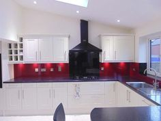 Wine red & black glass kitchen splashback by CreoGlass Design (London,UK). Two Tone Design is a very simple solution to overcome a difficult decision on colour. Your kitchen cupboards are white or cream we have a solution. #kitchen