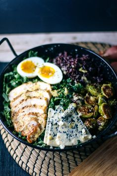 winter chicken + kale salad with roasted brussels sprouts, blue cheese, rice + shallot vinaigrette