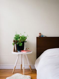 Paint simple stool partially white as bedside table—Photography byDabito