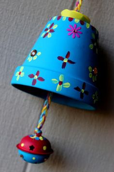 Cool! Hand painted clay pot, hang upside-down and turn it into a funky bell!