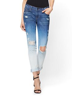 Chic contrast: an ombré wash creates an eye-catching effect on our laid-back Boyfriend jeans, finished with edgy destroyed detailing and silvertone hardware.