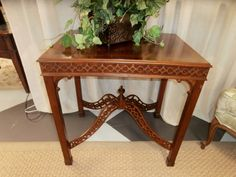 Chippendale styled accent table with detailed fretwork by Ethan Allen. Measures 28x21x28. Sorry just one. Arrived: Friday September 16th, 2016
