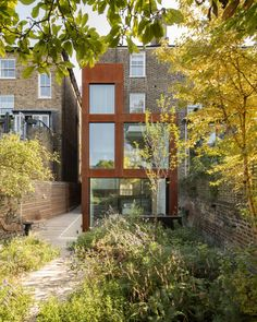 Architecture studio DeDraft has updated a semi-detached house in east London, wrapping a three-storey rear extension in weathering steel and introducing large windows that look out onto the garden. Semi Detached, Detached House, Steel Cladding, Concrete Staircase, Clad Home, London Fields, Weathering Steel, London Property, Rear Extension