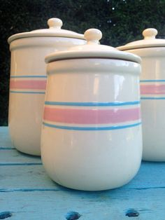 McCoy Container Set with Blue and Pink Stripes. When I was a girl, we had the matching bowls from this set; they were huge and my mom used them for bread making. I bought this container set in college but later gave it to my mom since I never used it and her farm kitchen has these colors. Now it would be considered antique! Sure brings back memories.