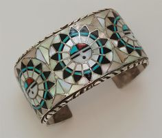 Cuff   Ralph & Lillie Kallestewa (Zuni).  Inlay Sun God Face; sterling silver, mother of pearl shell, turquoise, jet and coral.  ca. 1970s.