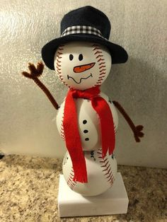 A great seasonal gift for the baseball lovers in your life! This baseball snowman is made out of real baseballs and is dressed up for the winter! Approximately 13 tall. Primitive Christmas, Christmas Snowman, Rustic Christmas, Simple Christmas, Christmas Holidays, Christmas Decorations, Christmas Ornaments, Primitive Snowmen, Primitive Crafts