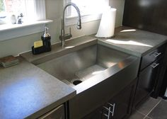 concrete counter tops  - the back of counter by the faucet is a separate seamed piece