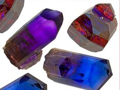 Tanzanite - see the trichroism - the stones rare ability to split light into three different colors when viewed from different angles - see here the blue, violet and burgundy axis !