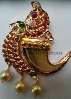 Jewellery Designs: Cabochon Rubies Peacock Pendant