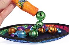 Players gather bells using the magnet wand, making a cluster or a string off the end. The first to collect 10 bells of any color—without picking up any other color—is the winner. The neoprene travel… read more