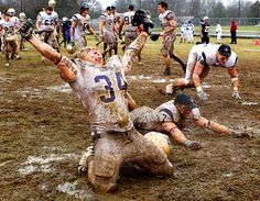 Carroll College linebacker Brandon Day slides in the mud after Carroll College's 17-9 victory over the University of Sioux Falls for the NAIA college football championship. Since 2002, Carroll College has won six NAIA championships, including one in 2010.