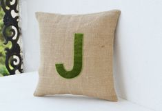 Monogrammed Burlap and Velvet Throw Pillow.  This natural burlap pillow adds just the right measure of rustic charm and toughness to the soft finesse of velvet letter. The two differently textured fabrics made a cheerful and soft statement.