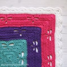 Free Crochet Pattern: Radiating Dragonflies Throw   Pattern Paradise green, orange,yellow, red, blue, Aqua, pink, purple