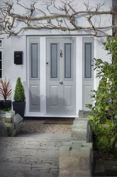 The Window Sanctuary offer a large range of Solidor Composite Doors in kent. We can quickly provide a fresh and uniquely secure entrance to your home. Porch Design, House With Porch, Door Color, Front Door, Doors, House Front, Grey Front Doors, Composite Front Door, House Exterior