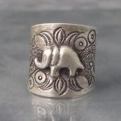 @Overstock - Featuring a unique chisel detailing, this stylish ring features a central elephant motif. Crafted with pure Thai Karen Hill Tribe silver, this ring contains over 99-percent pure silver with a smooth, satin finish.http://www.overstock.com/Worldstock-Fair-Trade/Karen-Hill-Tribe-Jungle-Elephant-Ring-Thailand/6510896/product.html?CID=214117 $35.99