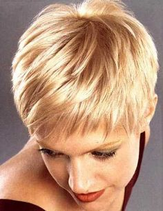 Very Cute and Alluring Copper Blonde-colored Pixie Minimize with Amazing Jagged Bangs. Like this color and cut!!