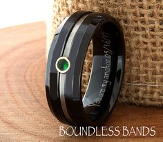 Cool looking men's wedding band with emerald