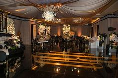The all black dance floored room featured the bride and groom's monogram in a glossy gold (Venue: @pelicanhillresort   Planner: @internationaleventco   Photographer: @curtisdahl   Video: @vidicamproductions   Florist: @marksgarden @michael_MarksGarden   Decor Draping Chandeliers: @revelryeventdesign @revelryMatias   Tent & Rentals: @tacer_losangeles   Lighting: @images_lighting   Ceremony Chairs: @classicparty   Band: @Westcoastmusicbevhills   Sound: @design.sound   Linens: @luxe_linen…