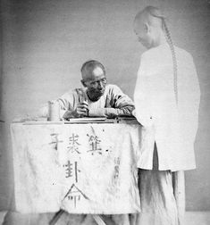 Down to business: A Chinese letter writer is photographed in the late 1860's. One intrigui...
