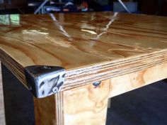 Plywood table with steel corner protectors Plywood Table, Plywood Furniture, Shelters, Corner, Steel, Plywood Desk, Animal Shelters, Shelter, Steel Grades