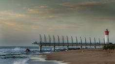 Umhlanga peer and lighthouse Wind Turbine, Lighthouse, Buildings, African, Explore, Holiday, Bell Rock Lighthouse, Light House, Vacations