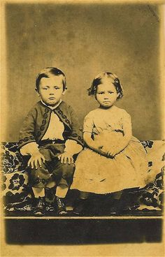 Love their expressions!  A look familiar, I'm sure, to many photographers of children's portraiture!