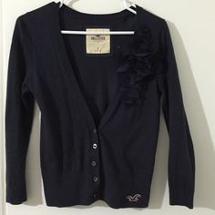 Hollister Cardigan Navy blue cardigan with large flower detail near left side. 3/4 sleeve length. Hollister Sweaters Cardigans