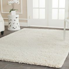 Add a warm and cozy addition to your living space with this ivory shag rug. This power-loomed rug is luxuriously comfortable and built to last for years. The solid ivory color is easy to match and compatible with most existing decors.