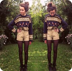 Combat boots, tights, high wasted shorts, vintage sweater.