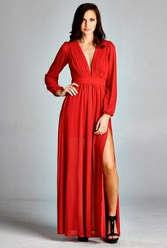 A stunning long sleeve maxi dress that will have everyone's head turning when you saunter into the room! The semi-sheer dress is partially lined and features a deep front v-neck and a thigh high split