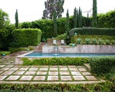 Spanish Oasis  Landscape designer Anthony Exter created a charming garden to compliment a Spanish-style home in Hollywood Hills. Incorporating simple concrete and stucco to create the walls of the pool and the stepping stones, and lush Mediterranean plants, this well-manicured oasis sends us straight to Europe. (Photographer: Steve Gunther)