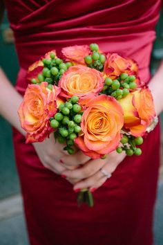 Gorgeous orange rose bouquet - love the bridesmaid gown too!