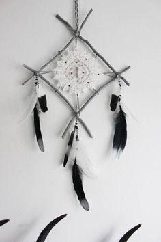 •. ☾Oracles Eye . ◦☽.⋆ Inspired by pagan culture, this craft wall-hanging was made with branches from the mystical forest of La Fosse Arthour in Normandy. Adorned with a vintage doily and duck and goose feathers, this protection rune is embroidered with Swarovski crystals and a raw
