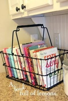 """From @A Bowl Full of Lemons comes this simple and attractive idea for storing cookbooks that you use regularly. She says, """"I use a cookbook several days out of the week… so having them here is much easier for me! I got my basket at Hobby Lobby on clearance for $17.00."""" #cookbooks #storage"""