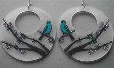 Birds on a tree branch shrinky dink earrings.