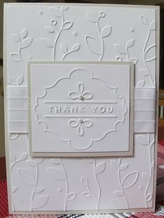 white card with embossing on top of embossing. wedding card?