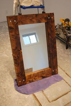 Great tutorial for this DIY mirror -- easy woodworking!