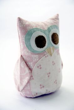 This is a custom-made listing for one owl nursery decor and plush toy in shades of pink & cream. Sally is sure to bring cheer to any room and child! The design is created by Terri Degenkolb. I use high quality 100% cotton fabrics for the exterior and hobby fill and plastic pellets for the interior. The eyes, beak and belly are hand-appliqued, while the body is machine stitched.  The owl plushie featured looks very cute as a beautiful decor for your childs room or nursery. It is not 100% s...
