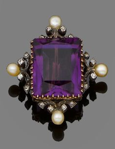 An amethyst and diamond brooch  The scissor-cut amethyst framed by old brilliant-cut diamond and pearl scrolls