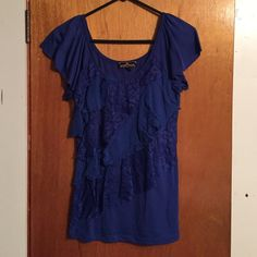 Blue lace dressy top Worn once blue lace ruffle top Almost Famous Tops Tunics