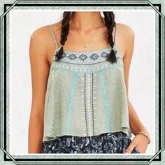 Ecote Zodiac Cami from Urban Outfitters Beautiful embroidered cami from boho brand Ecote. Short + swingy pull-on silhouette cut in a relaxed fit. Features allover embroidered detailing finished with a banded scoop-neck, scoop-back, and armholes and thin adjustable straps. Rayon. Machine Wash. NWT. Urban Outfitters Tops Tank Tops
