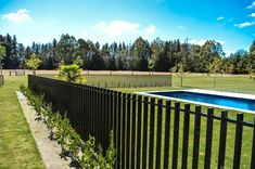 DuraPanel Axis Aluminium Fences are one of a range of high-quality fencing, gate and bollard products. New Zealand's fencing specialists. Dog Window In Fence, Diy Dog Fence, Round Pool, Rectangular Pool, Aluminum Pool Fence, Fencing For Sale, Kidney Shaped Pool, Small Fountains, Types Of Fences